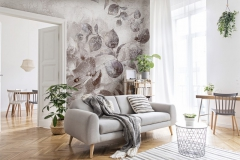 Stylish scandinavian living room with design furniture, plants, bamboo bookstand and wooden desk. Brown wooden parquet. Abstract painting on the white wall. Nice apartment. Modern decor of bright room