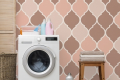 Modern washing machine near color wall in laundry room interior, space for text